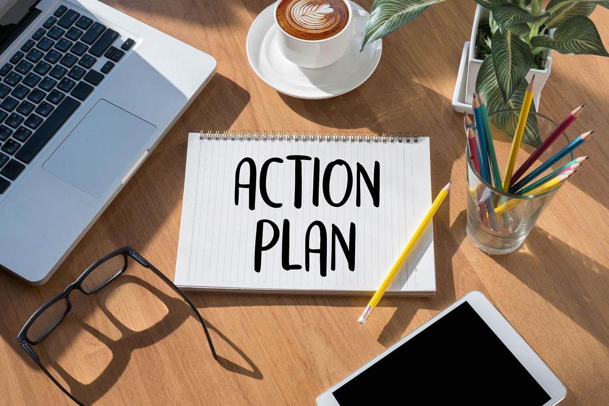 Notepad with the words action plan