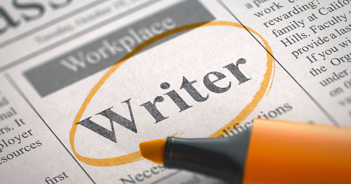 Close-up of newspaper job ad with the word writer circled in highlighter