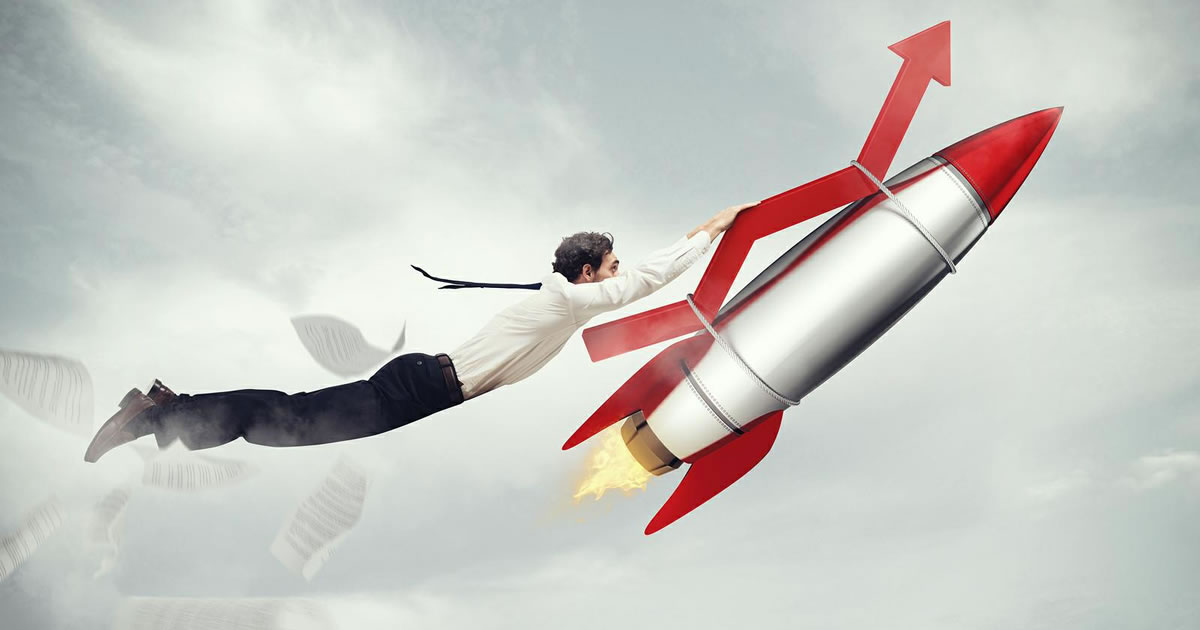 Businessman holding an increasing arrow attached to a rocket flying upward