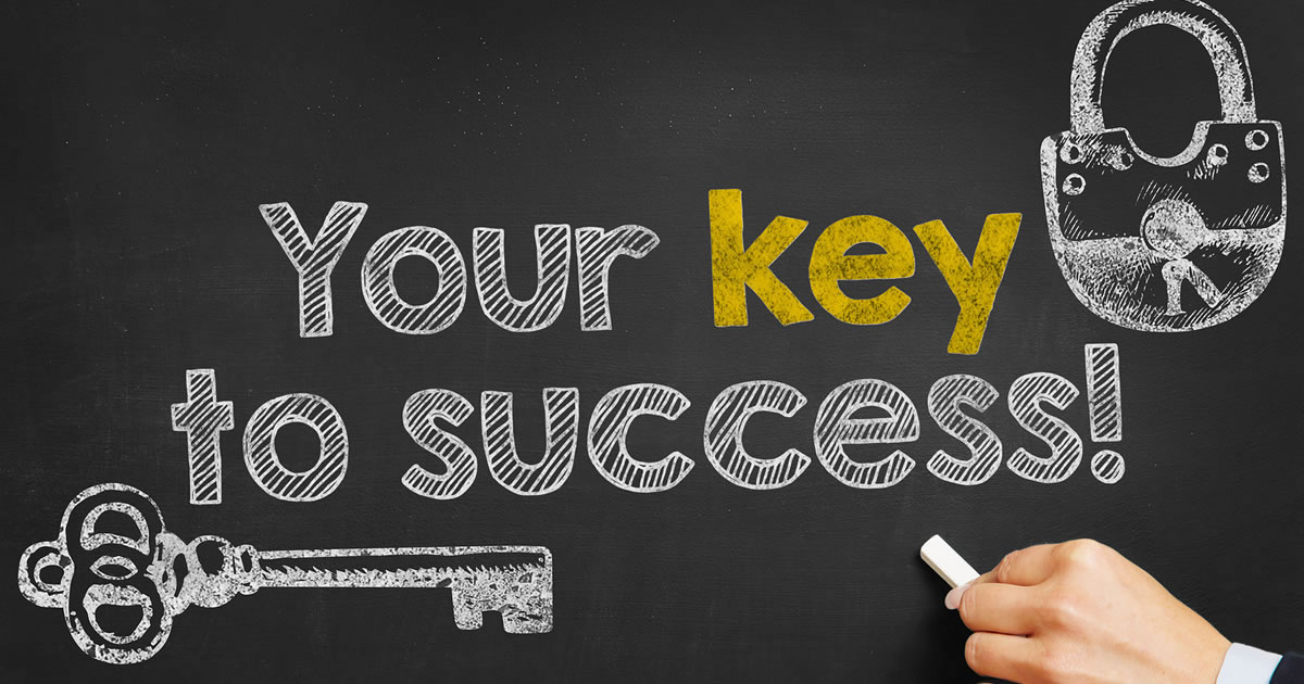 Chalkboard with drawing of a lock and key and the words key to success