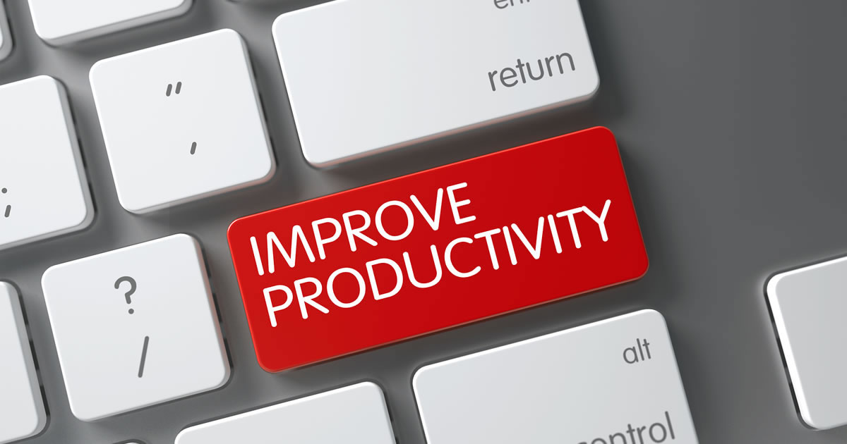 Close-up of computer keyboard with one red key that says improve productivity