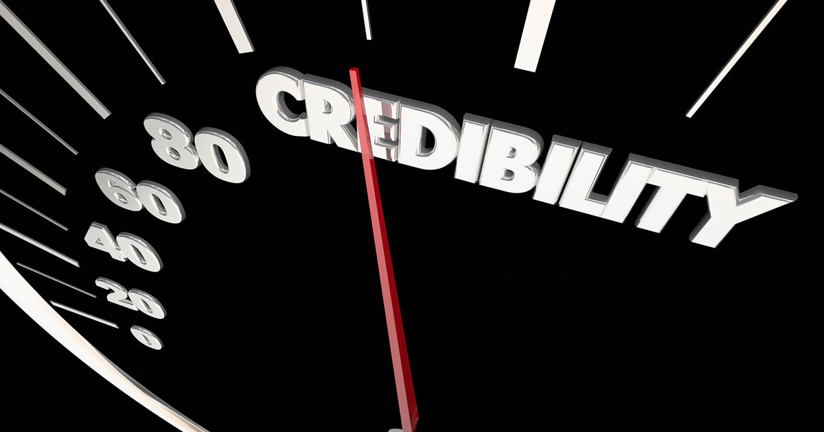 Graphic of speedometer registering the word credibility