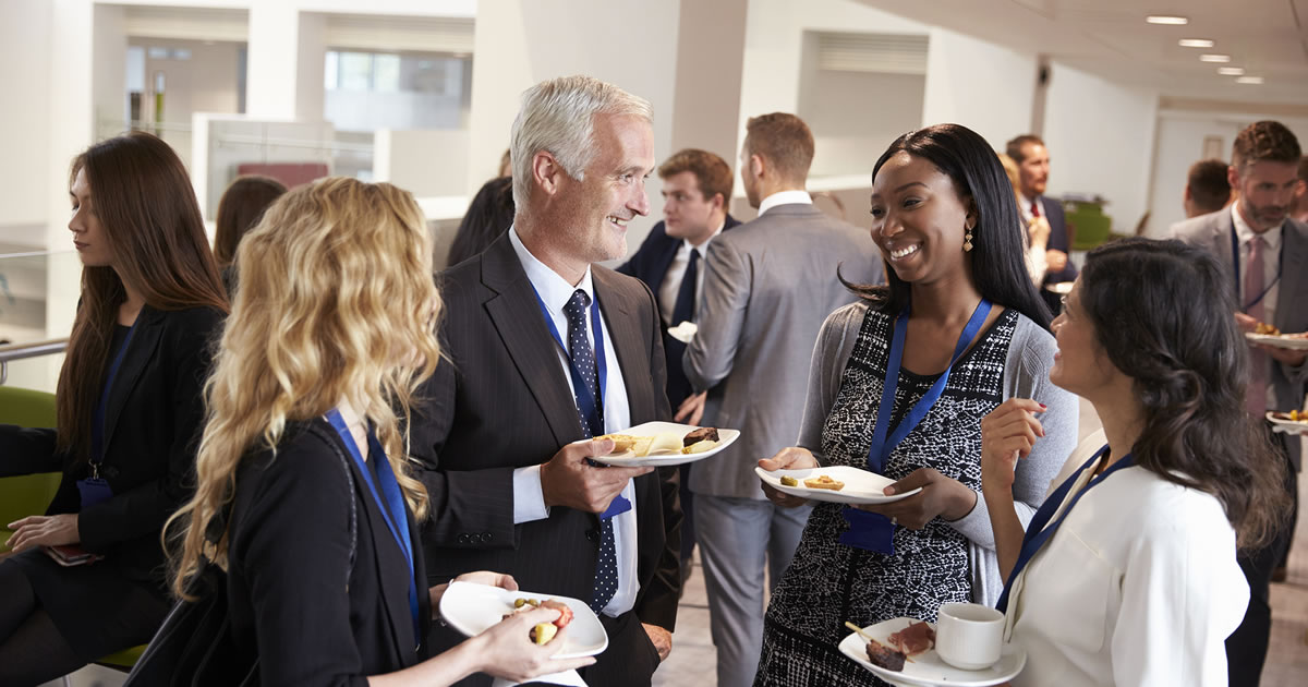 Group of business people talking at a networking event