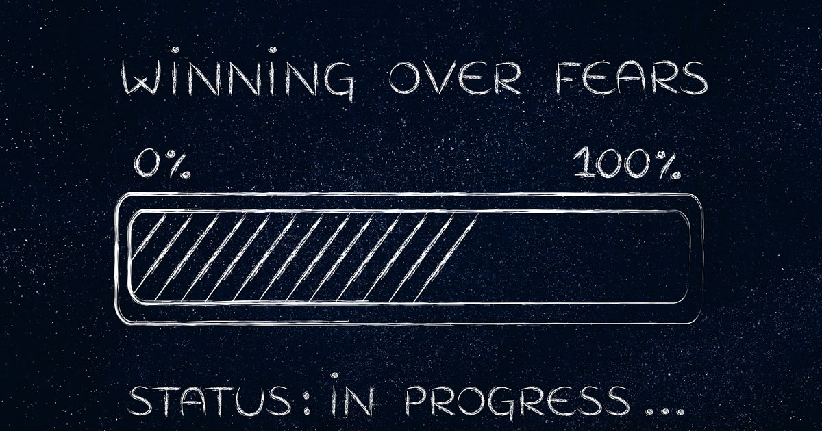 Chalkboard image of the words winning over fears and a charging battery icon followed by the words status in progress