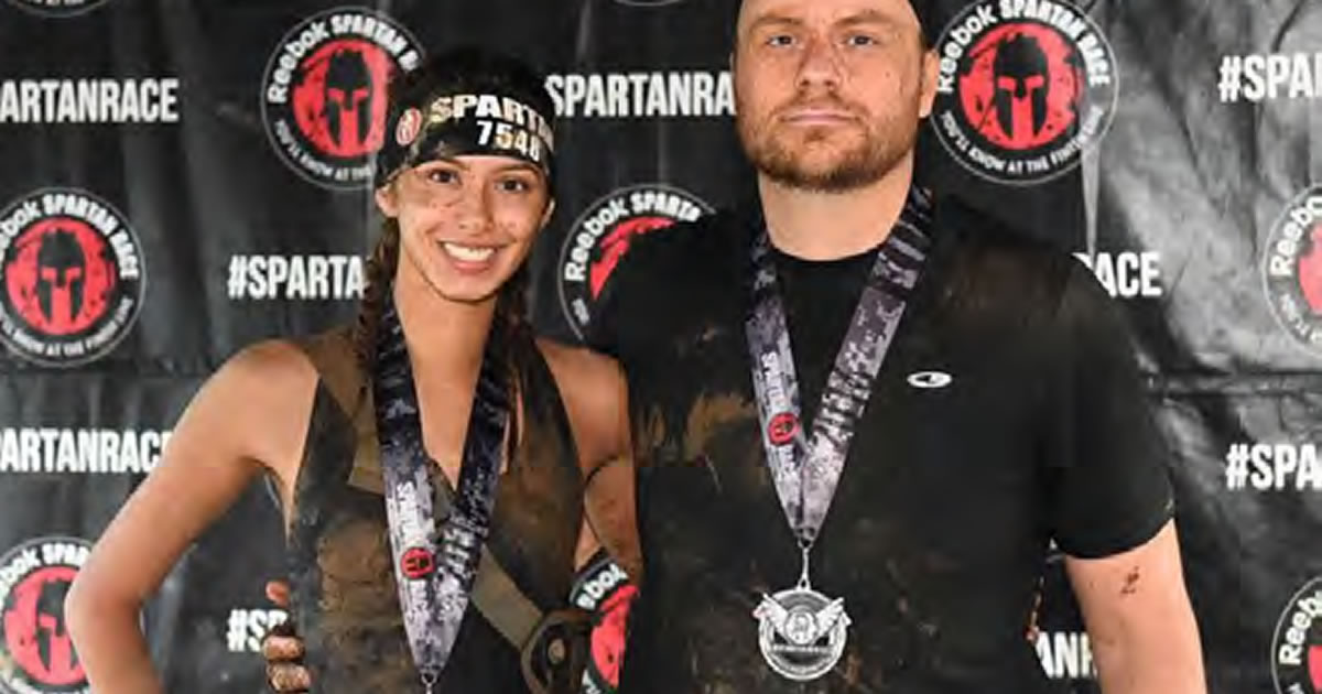 Photo of writer Kevin Hoover and his wife at the Reebok Spartan Race