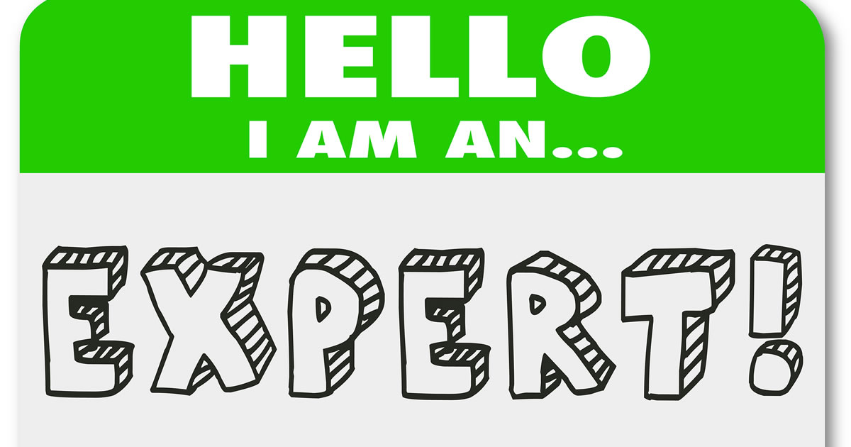 Graphic of a name tag sticker with the words hello I am an expert