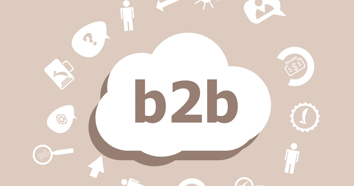 Graphic of word b2b in a cloud surrounded by related business icons such as briefcase and question mark