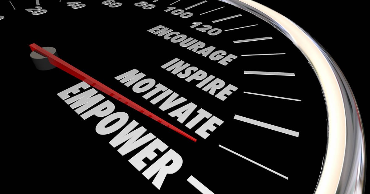 Speedometer registering at the words Motivate and Empower