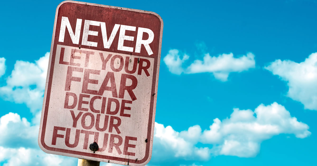 Street sign displaying the words Never Let Your Fear Decide Your Future