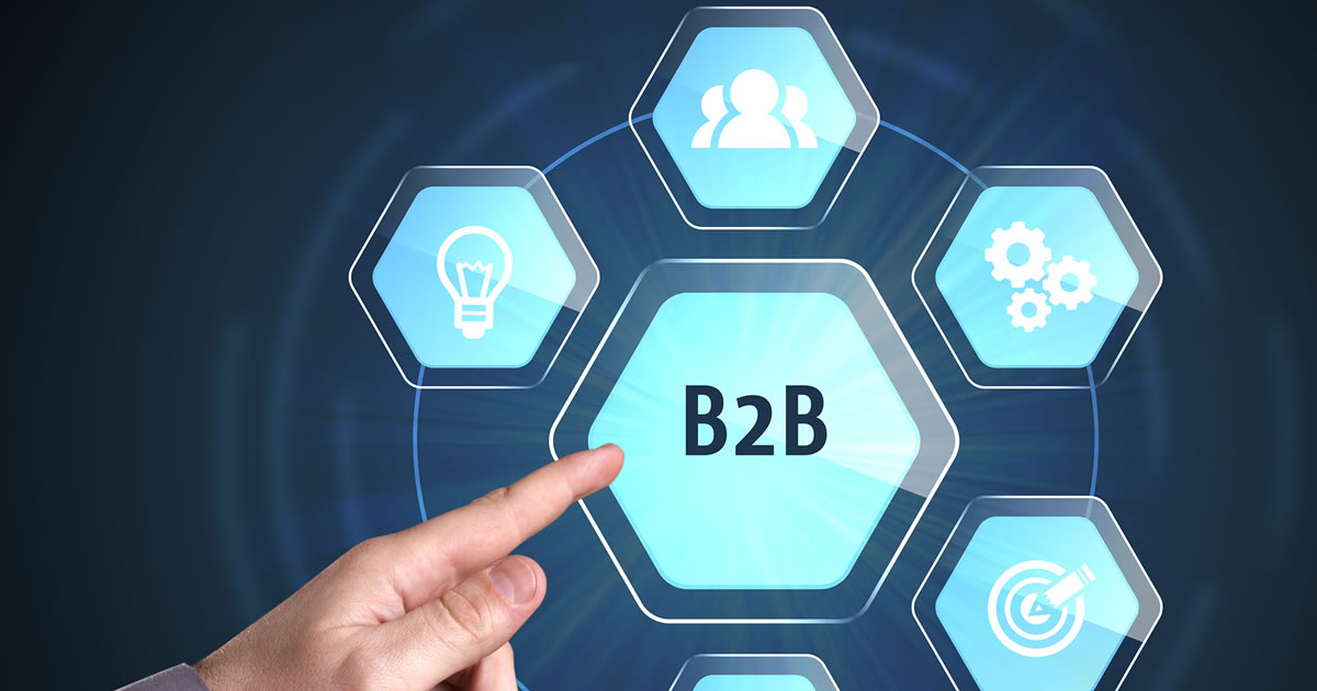 Businessman points to the word B2B and surrounding business technology internet icons