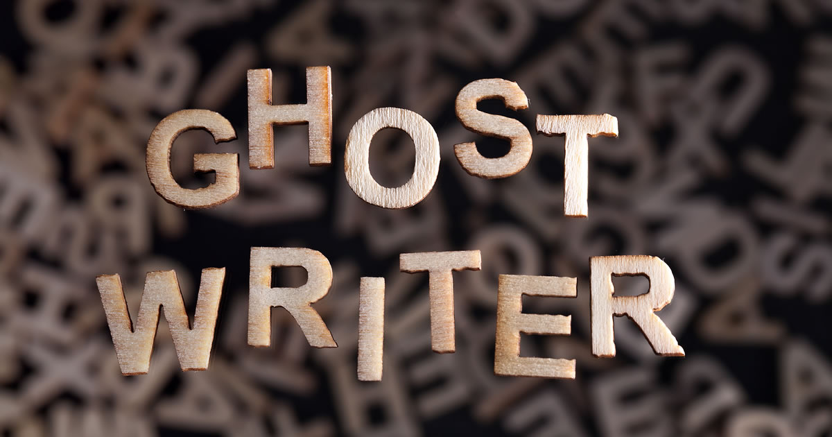 Ghostwriter written in wooden letters floating above random letters out of focus