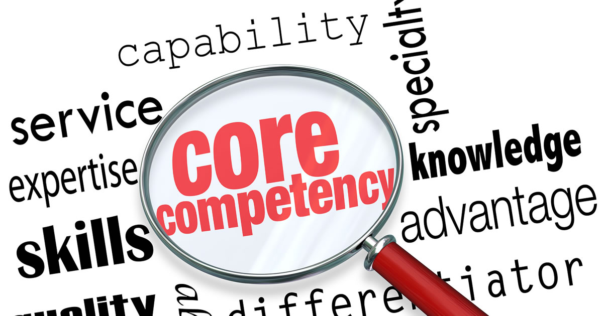 Core Competency words under a magnifying glass to illustrate a unique capability, skill, quality, or other differentiator or advantage