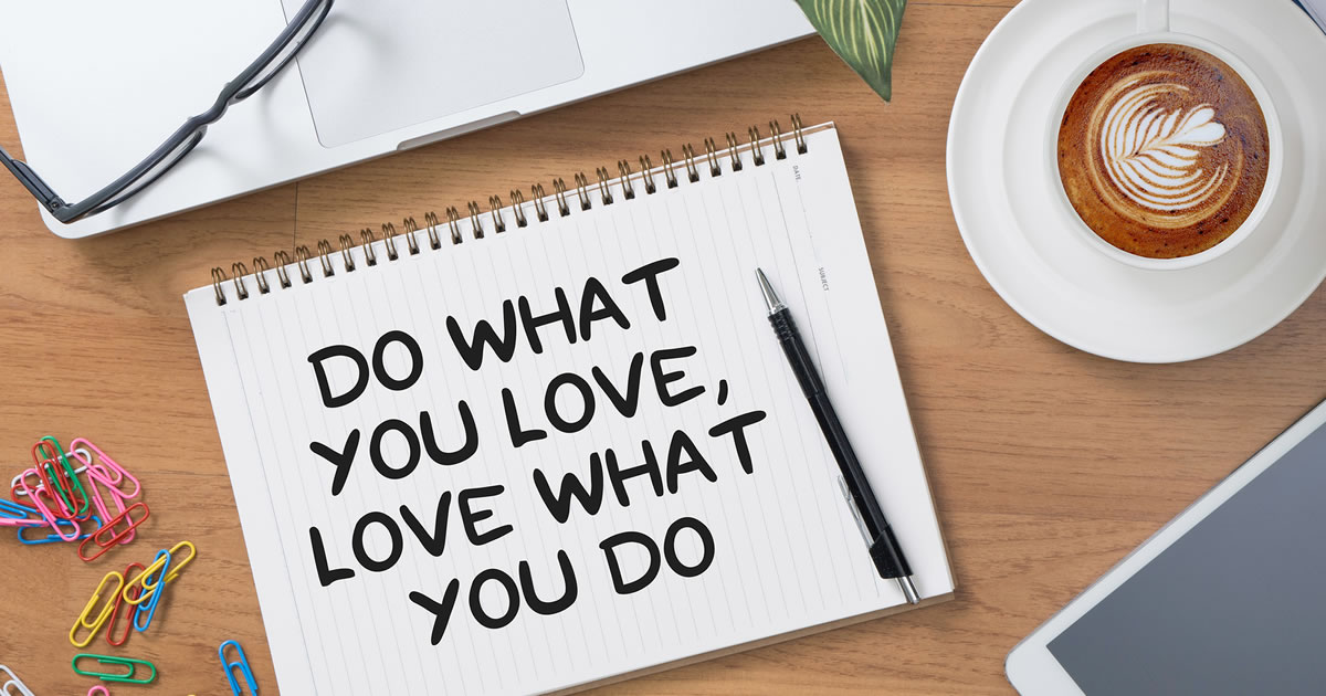 Do What You Love, Love What You Do writing on tablet of paper with laptop and coffee cup nearby