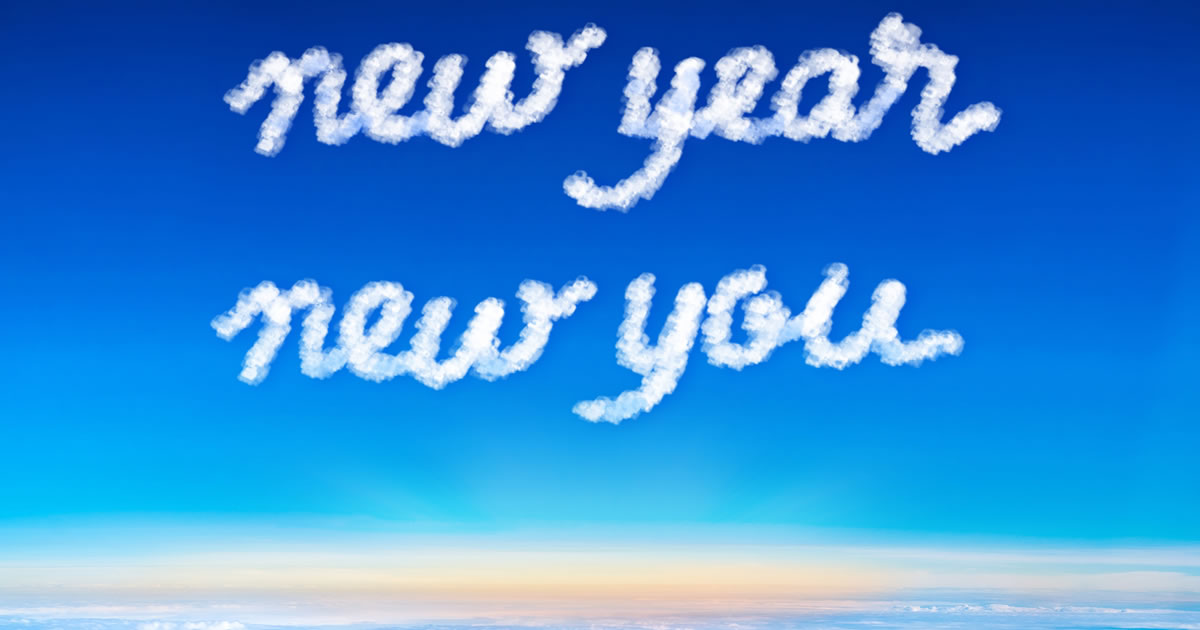 Inspiration quote: New Year, New You written in cloud text on blue sky and sunrise