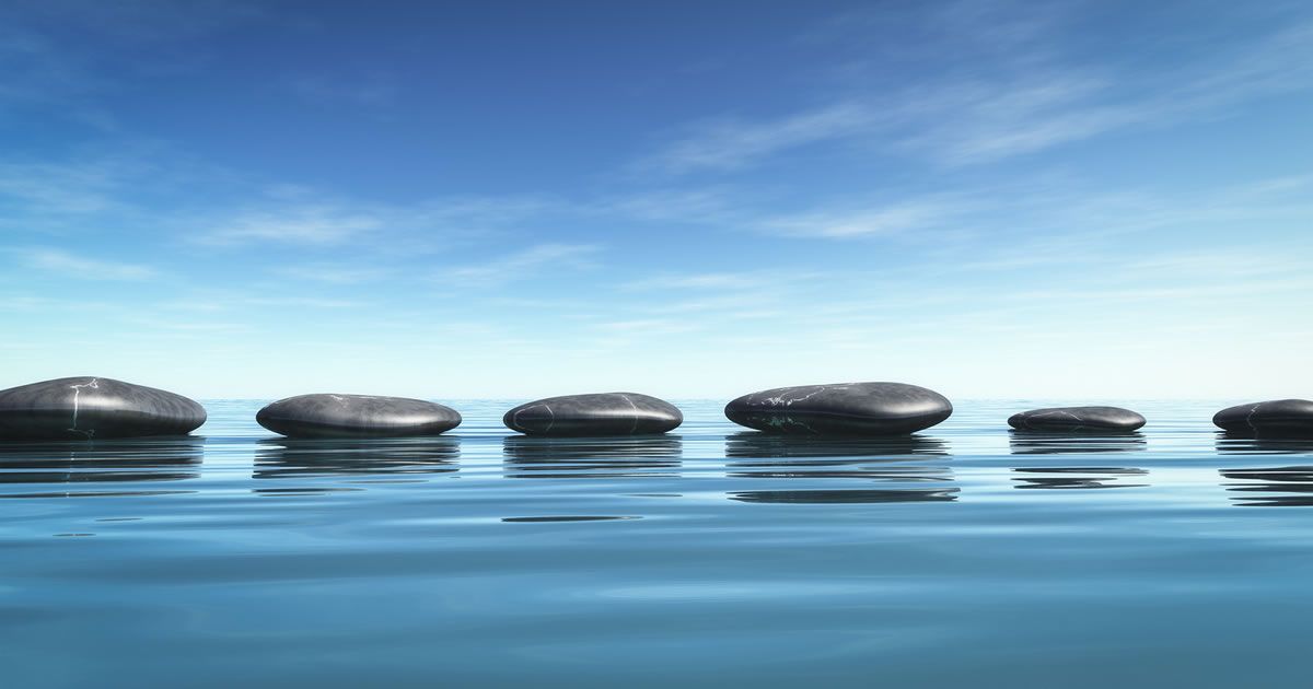 An image of some smooth stepping-stones in the blue sea