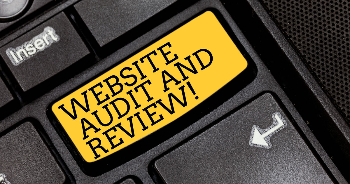 Text reading Website Audit and Review on black computer keyboard key