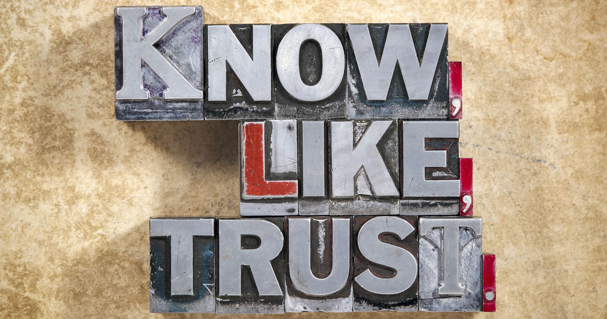"marketing tenet ""know like trust"" words made from metallic letterpress type on grunge background"