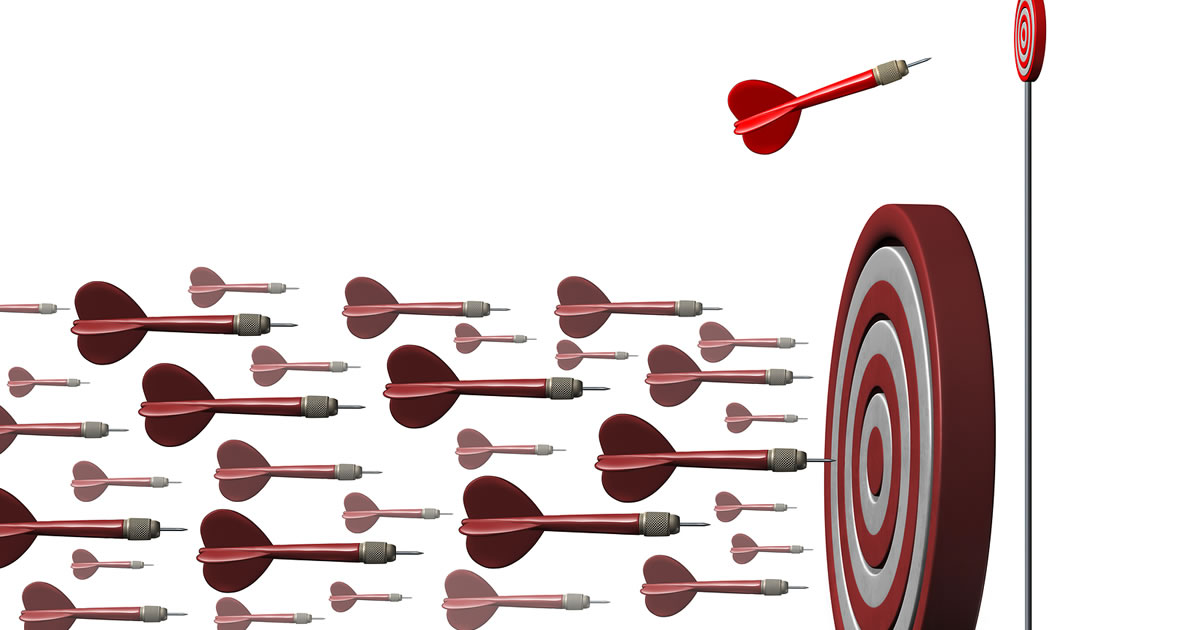 Niche specialization concept illustrated by an individual dart going toward a focused target opportunity away from a large group of darts as a metaphor for strategic specialization