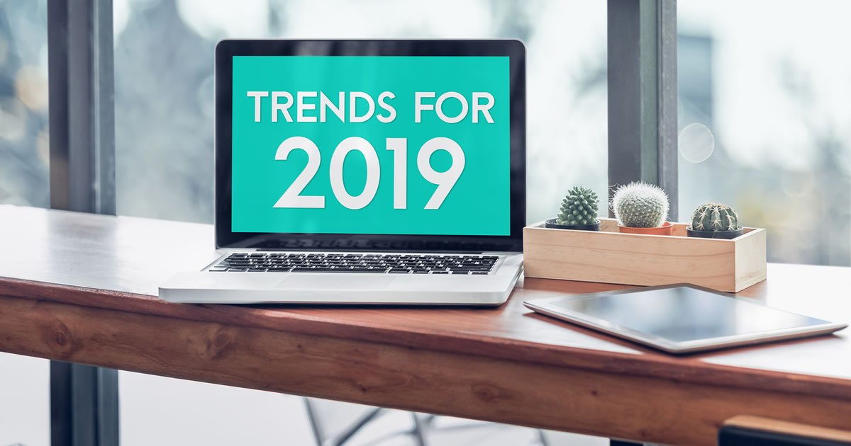 Trends for 2019 written on laptop computer screen on wood table
