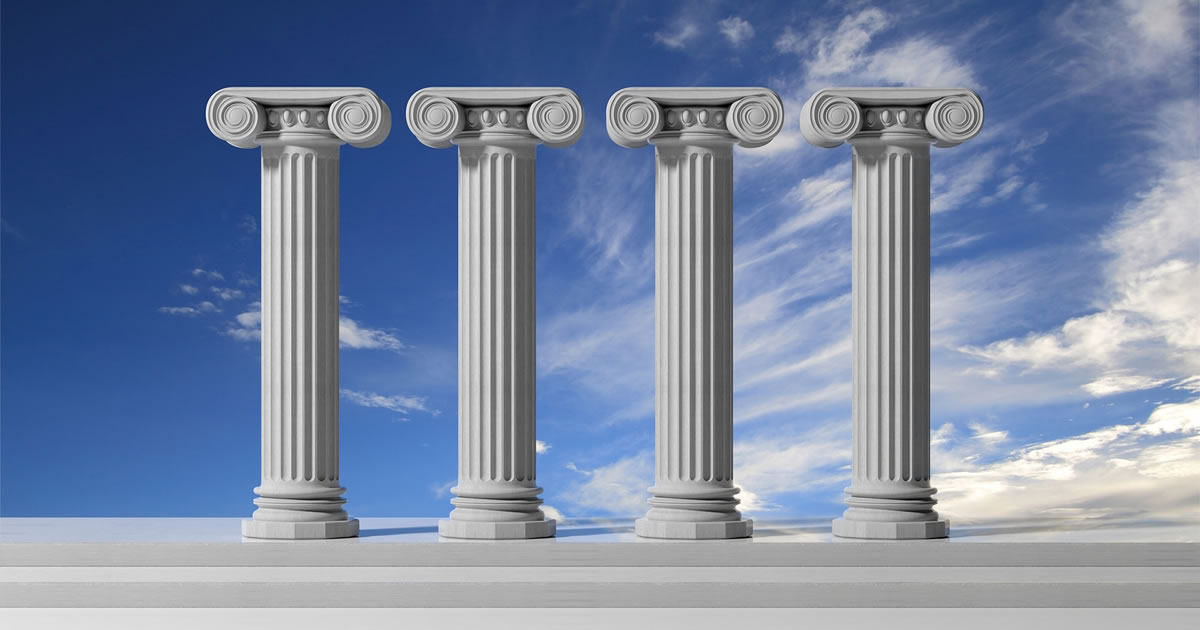 4 solid ancient pillars again a blue sky background
