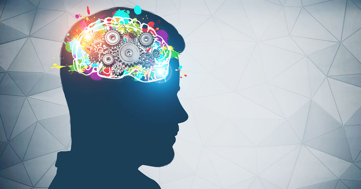 Silhouette of man head with colorful brain with gears inside it near wall with geometric pattern