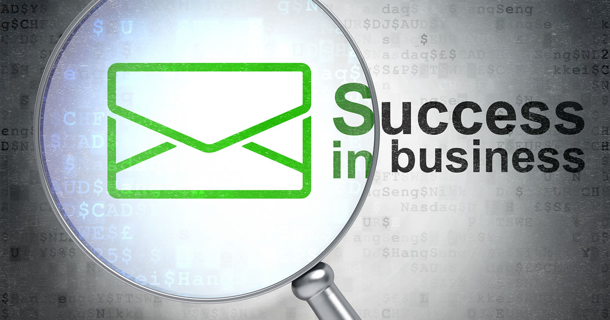 Email marketing icon under magnifying glass with written Success in Business