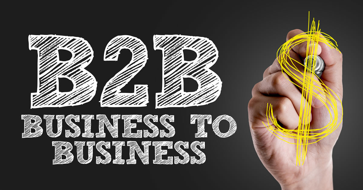 Hand writing the text B2B Business-to-Business and $ on a chalkboard
