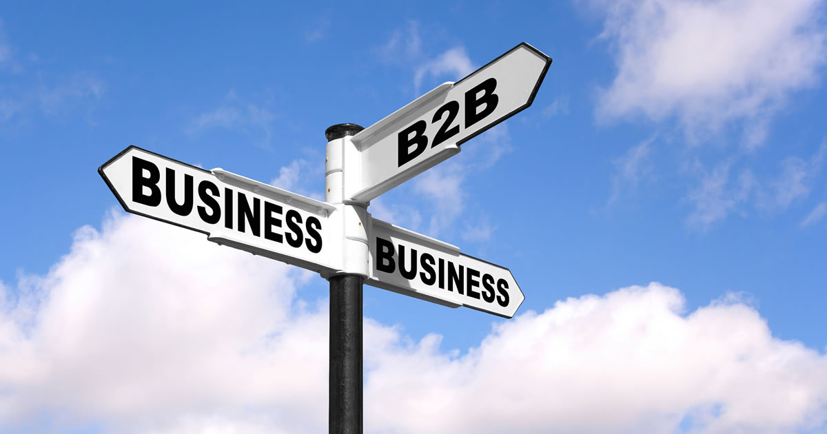 Black and white signpost with the words B2B Business-to-Business against sky