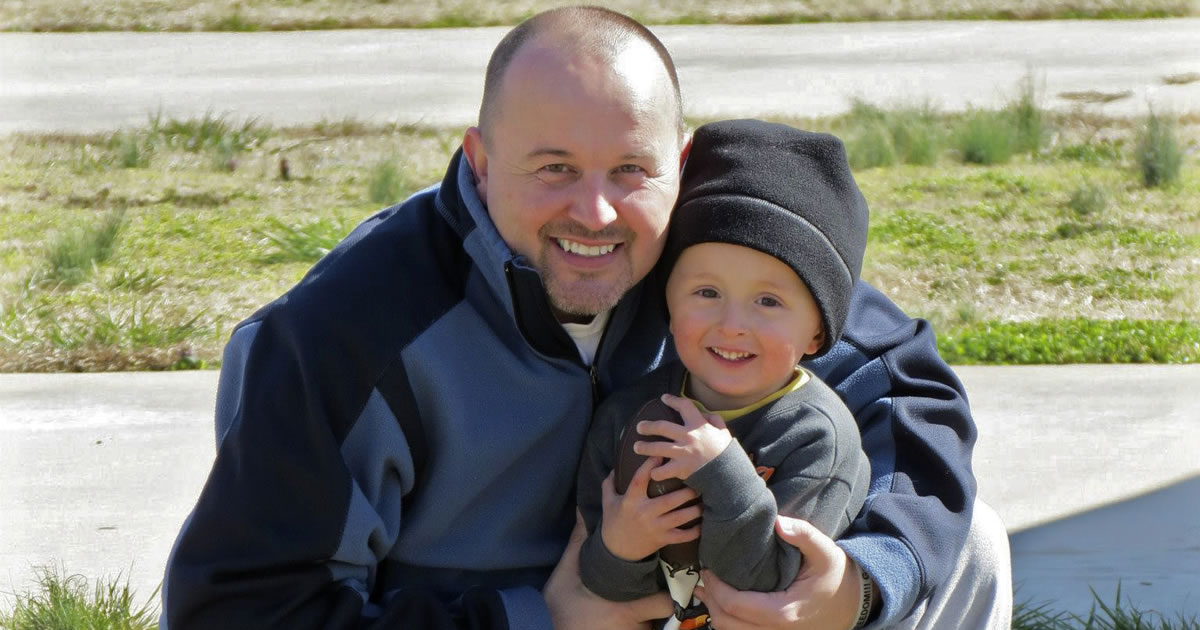 AWAI Member and copywriting success Joshua Vickery and his son enjoying time together outside