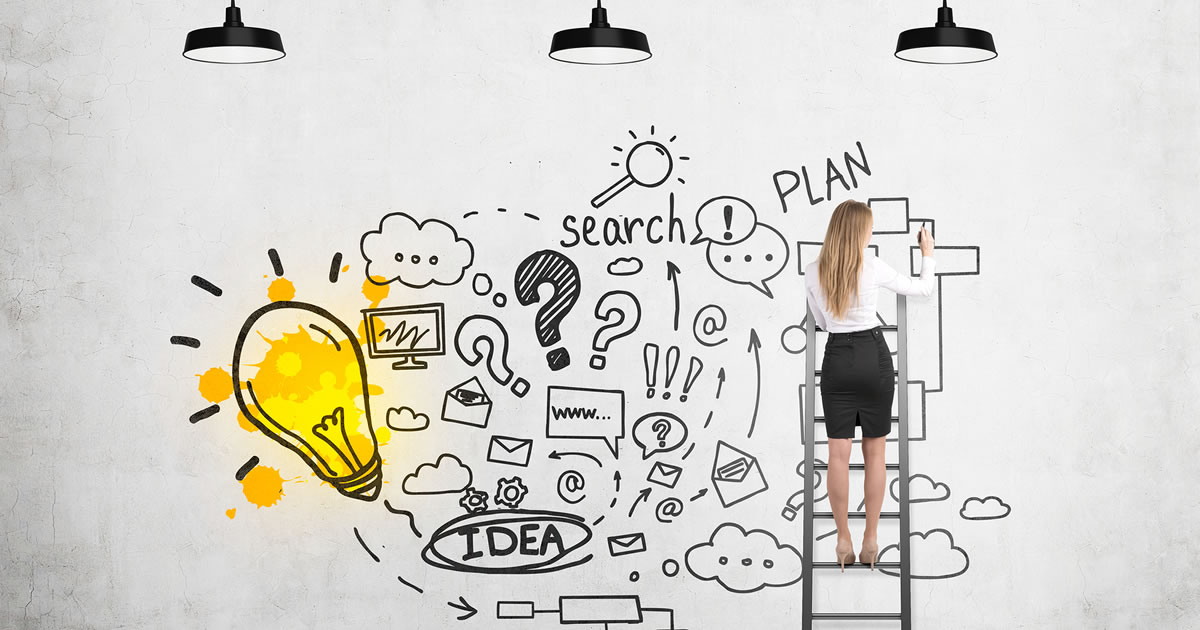 Woman with back to camera standing on ladder and sketching large marketing and business success plan with yellow idea light bulb on concrete wall