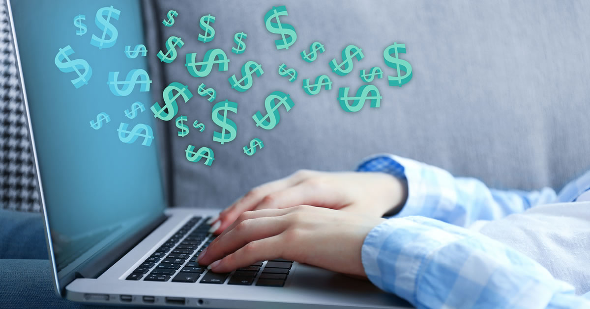 Making money online gig concept. Woman typing on a laptop with dollar signs flying out of the screen