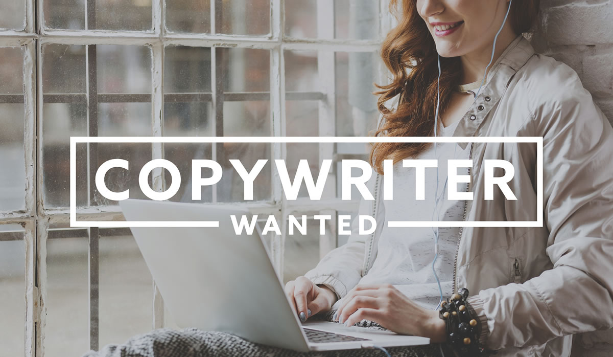 Smiling woman typing on laptop with Copywriter Wanted text overlay