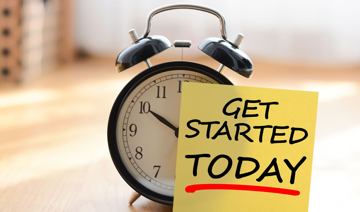 Start today your own business concept with alarm clock and post it message reading GET STARTED TODAY