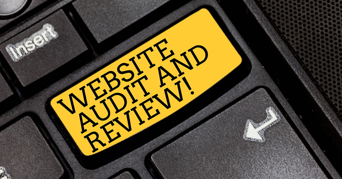 Text that says Website Audit and Review on a black computer keyboard key