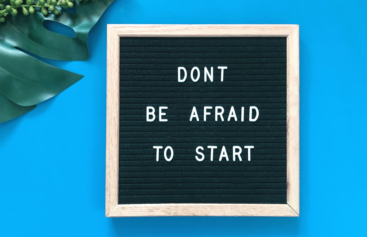 "Sign reading ""Don't be afraid to start"""