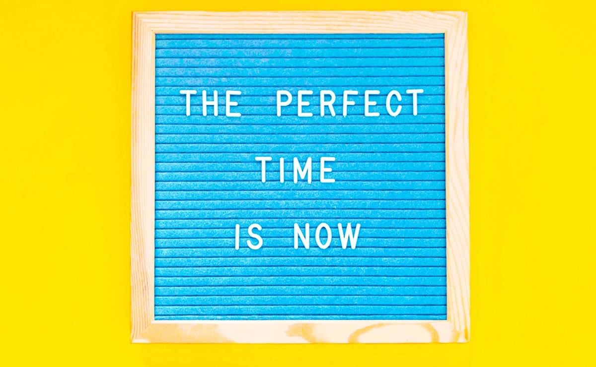 Sign with the words the perfect time is now