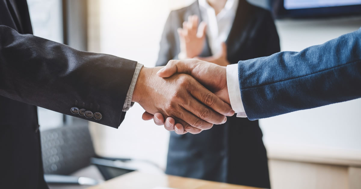 Businessmen shaking hands after agreeing to a business deal