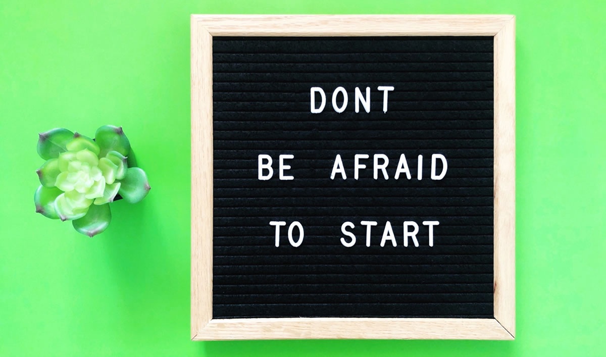 Letterboard sign with the words Don't be afraid to start