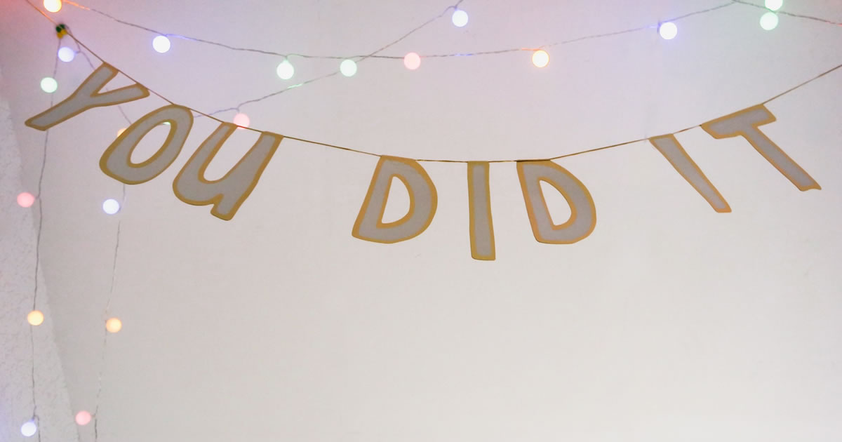 You Did It celebratory banner with string lights
