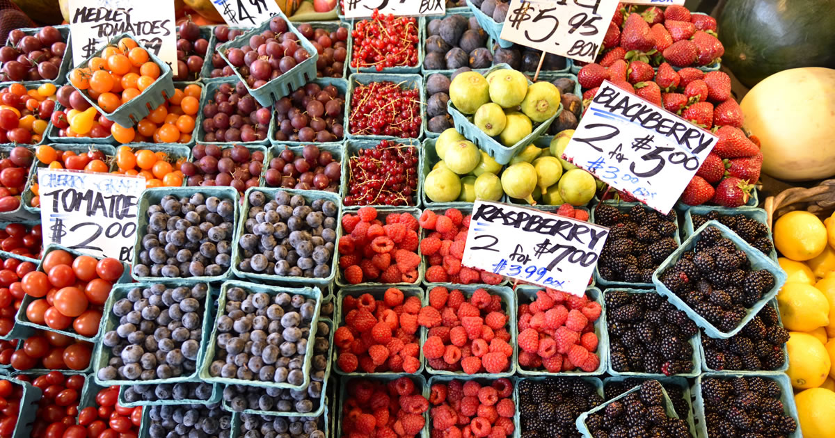 Assorted berries at a farmers market in vibrant colors