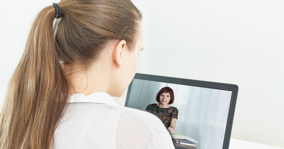 Woman in a video chat meeting with another woman
