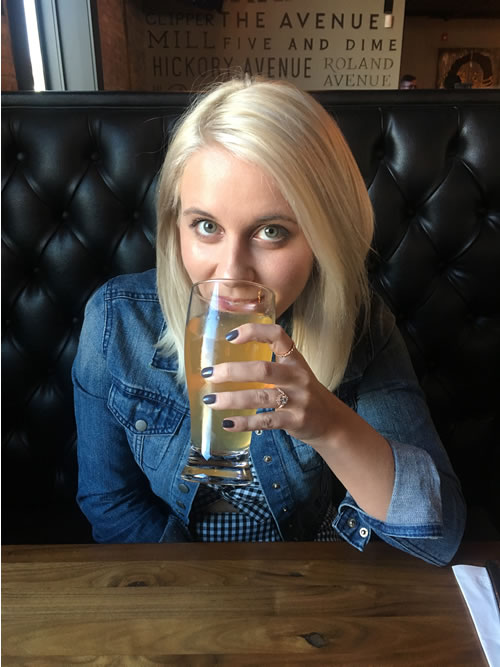 Photo of copywriter Allison Comotto drinking her favorite beer at her favorite Happy Hour spot