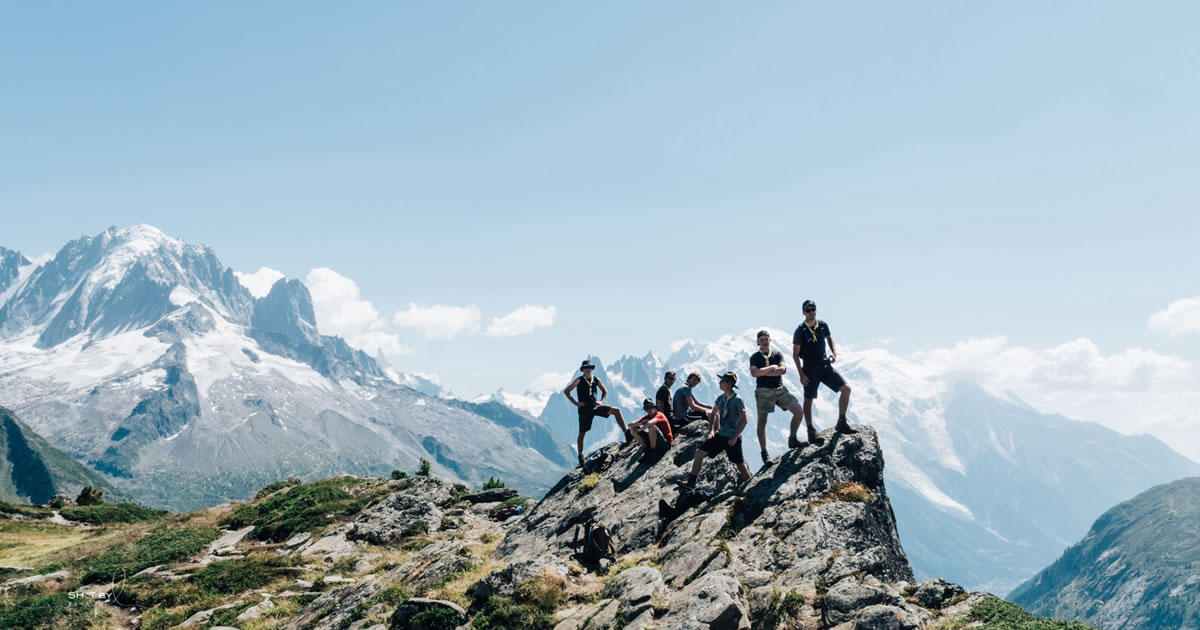 Together Everyone Achieves More – group on mountain top