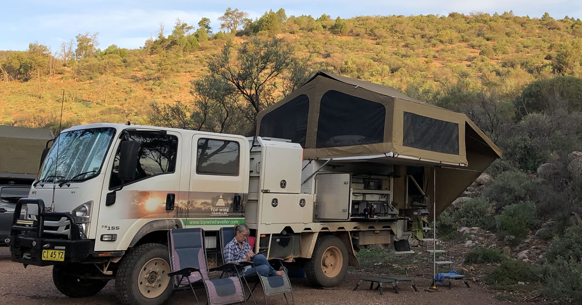 Peta M. working outside by camper in Australia's Outback