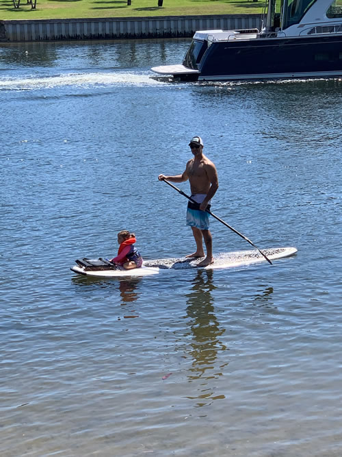 Writer Rob Gramer paddleboards with his daughter near their Florida home