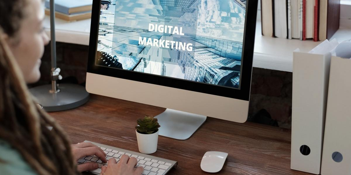 woman looking at desktop screen which reads Digital Marketing