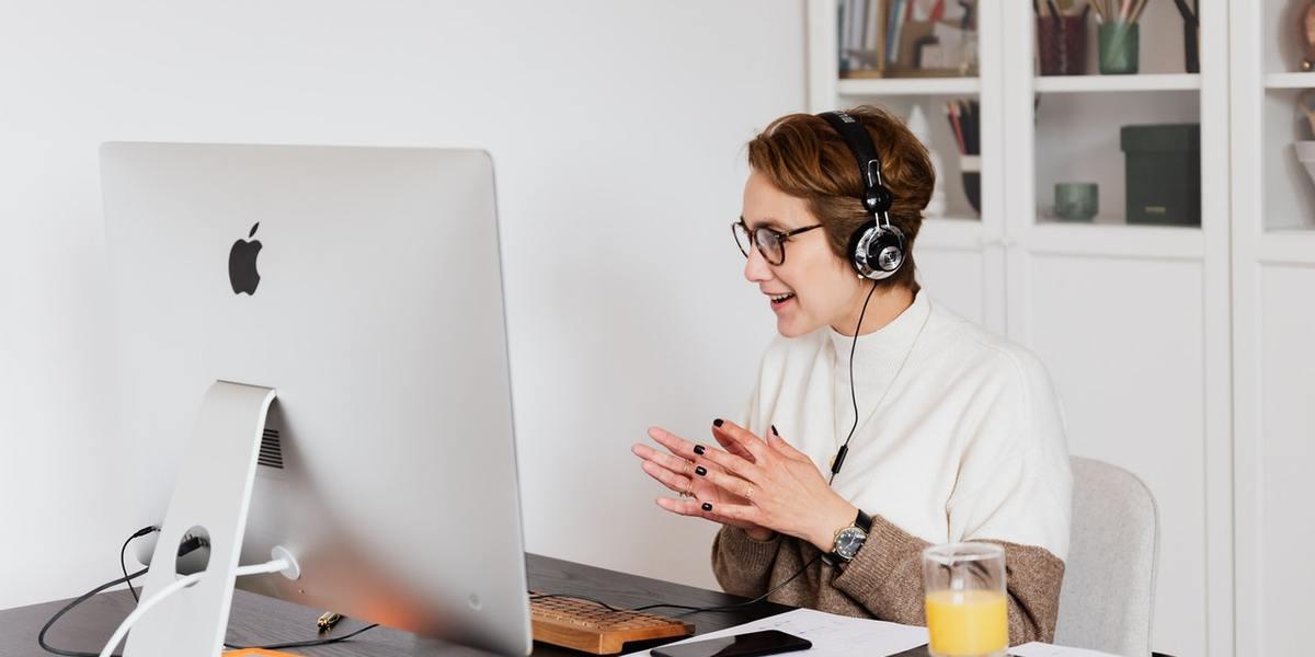 happy woman taking part in online webinar training