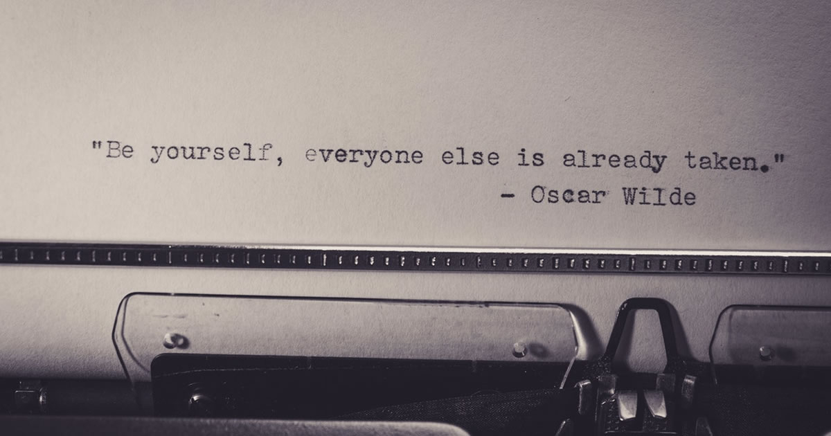 vintage typewriter with words typed on white paper be yourself everyone else is already taken
