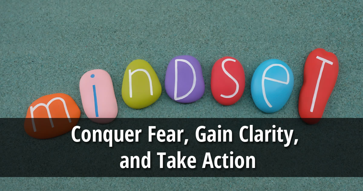 Smooth colorful rocks spelling out the word mindset with overlay of text that says Conquer Fear, Gain Clarity, and Take Action