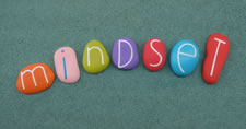 Smooth colorful rocks spelling out the word mindset